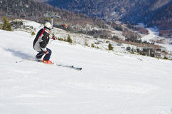 Skier on the mountain side Royalty Free Stock Image