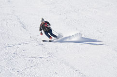 Skier on the mountain side Royalty Free Stock Photos