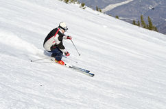 Skier on the mountain side Stock Images