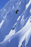 Skier On Mountain Slope. High angle view of skier skiing on mountain slope Royalty Free Stock Photography