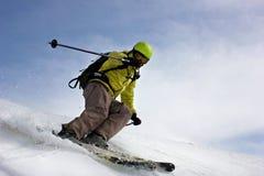 Skier on mountain slopes Stock Image