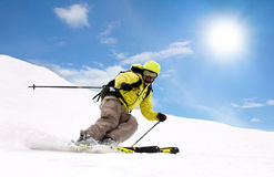 Skier on mountain slopes Stock Images