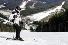 Skier on the mountain. Skier stands on top of the mountain at the beginning of downhill Stock Images