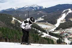 Skier on the mountain. Skier stands on top of the mountain at the beginning of downhill Stock Photo