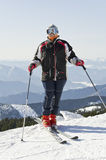 Skier on the mountain top Royalty Free Stock Photo