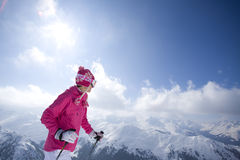 Skier on mountain top looking at mountains Royalty Free Stock Image