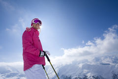 Skier on mountain top looking at mountains Stock Image