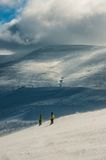 Skier in mountains, prepared piste and sunny day Stock Image