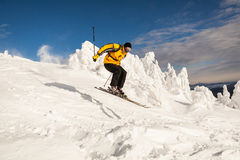 Skier in mountains Stock Images