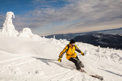 Skier in mountains Royalty Free Stock Image