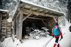 Skier near the garage of the modern snow plough in Mummelsee Stock Images