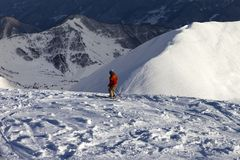 Skier on off-piste slope in sun evening Stock Photos
