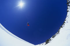 Skier Performing Flip On Snow Mountain Stock Image