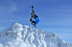 Skier performing a high jump Stock Photography