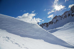 Skier on pise in high mountains Royalty Free Stock Photography