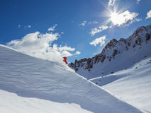 Skier on pise in high mountains Royalty Free Stock Images