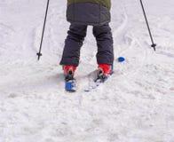 Skier on piste in mountain snow Royalty Free Stock Photos