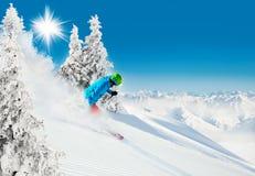 Skier on piste running downhill Stock Photography