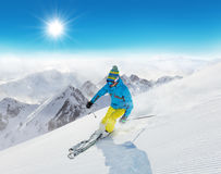 Skier on piste running downhill Royalty Free Stock Photography