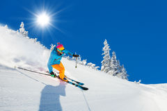 Skier on piste running downhill Royalty Free Stock Images