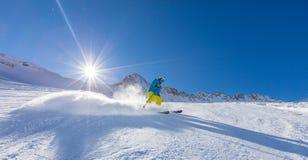 Skier on piste running downhill Stock Photos