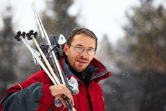 Skier portrait and snowfall Stock Photography