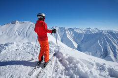 Skier is posing at camera at Gudauri resort in high mountaing of Stock Photo