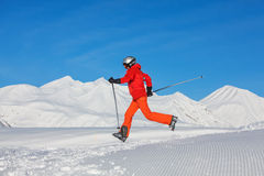 Skier is posing at camera at Gudauri resort in high mountaing of Royalty Free Stock Photos