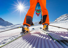 Skier posing on piste in high mountains Stock Images