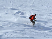 Skier in powder snow. Off trail skiing in deep powder snow Stock Photo