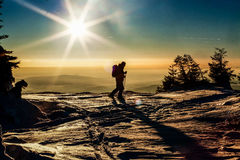 skier reaching the summit at sunset Royalty Free Stock Photography