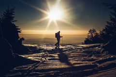 skier reaching the summit at sunset Royalty Free Stock Images