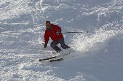 Skier in red Royalty Free Stock Photo