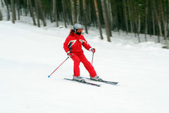 Skier in red suit Stock Image