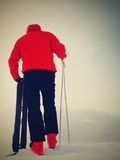 Skier in red winter jacket with  fun snowshoes stay in snow in mountains. Royalty Free Stock Photography