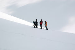 Skier refreshing. Four skiers looking track and rest Stock Image