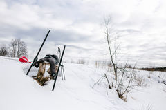 Skier relaxing on bench after a long hike Stock Image