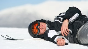 Skier relaxing on snow Royalty Free Stock Image