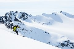 Skier among remote peaks of Alaska. Backcountry skiing in the Talkeetna Mountains. Backcountry skier on remote Alaskan peaks in the Talkeetna Mountains. Large stock image