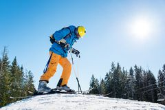 Skier resting on top of the mountain Royalty Free Stock Photos