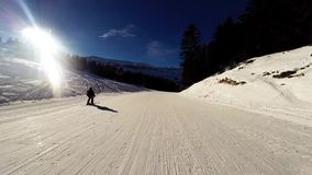 A skier rides down a difficult ski run on a sunny day in the French Alps, stock video footage