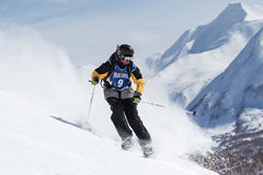 Skier rides steep mountains. Kamchatka, Far East, Russia Royalty Free Stock Photo