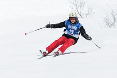 Skier rides steep mountains. Kamchatka Peninsula, Far East. KAMCHATKA, RUSSIA - MARCH 9, 2014: Skier rides steep mountains. Competitions freeride skiers and Royalty Free Stock Photo