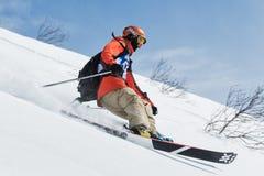 Skier rides steep mountains. Kamchatka Peninsula, Far East, Russia Royalty Free Stock Photo