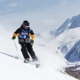 Skier rides steep mountains. Kamchatka Peninsula, Far East, Russia Royalty Free Stock Photography