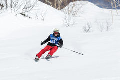 Skier rides steep mountains. Russia, Far East, Kamchatka Peninsula Stock Photography