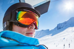 Skier riding a chairlift Royalty Free Stock Photo