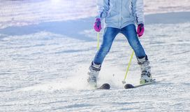 Skier is riding from the mountain. Skier rides from the mountain at shallow depth of field stock image