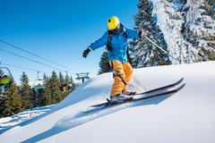 Skier riding in the mountains on a sunny winter day. Professional freeride skier skiing in the mountains on a sunny winter day nature recreation active sportive Royalty Free Stock Photo