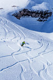 Skier riding. Skier riding off the track on the background of rocks Stock Photography